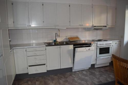 A kitchen or kitchenette at Abisko Hostel