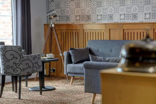 A seating area at Allerton Court Hotel