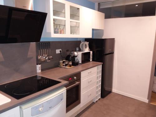 A kitchen or kitchenette at marseille la phocéenne