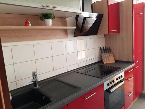 Küche/Küchenzeile in der Unterkunft Apartment City Laatzen