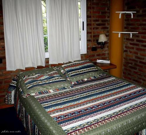 Una cama o camas en una habitación de Complejo Nailut
