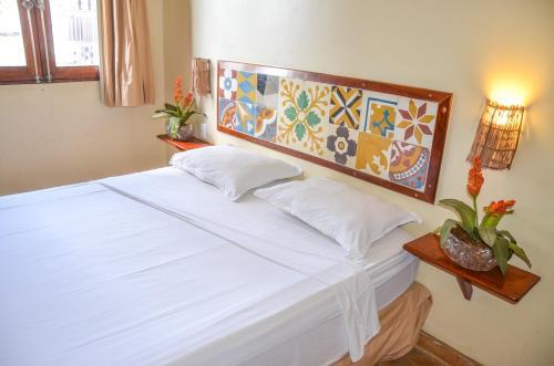 A bed or beds in a room at Pousada Fortal Villa Praia