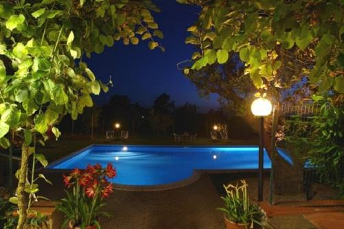 The swimming pool at or near Country House Maremma Nel Tufo