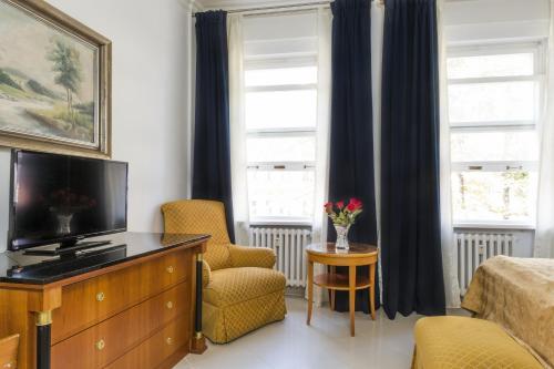 TV a/nebo společenská místnost v ubytování Residence Bologna