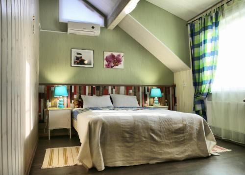 Кровать или кровати в номере Мини-Отель «Берлога-Сити»