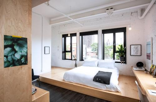 A bed or beds in a room at The Annex Hotel