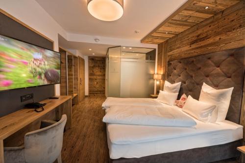 A bed or beds in a room at Hotel Eldorado