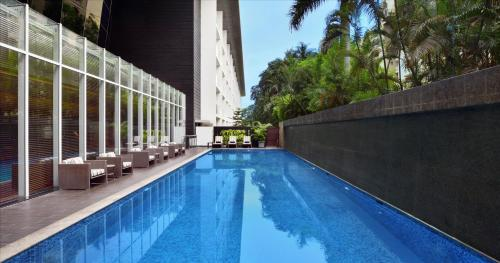 The swimming pool at or close to Marriott Suites Pune