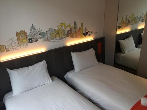 A bed or beds in a room at easyHotel Belfast