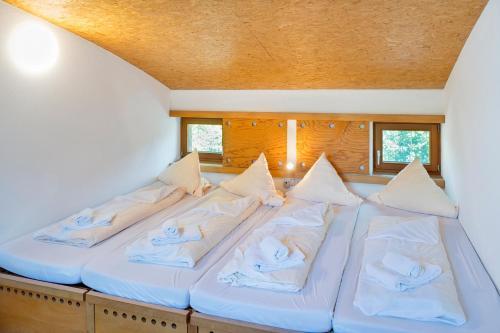 Кровать или кровати в номере Naturfreundehaus Bodensee