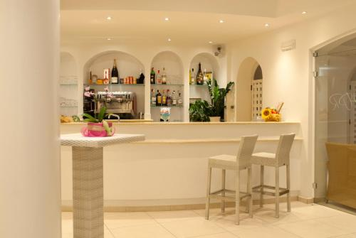 The lounge or bar area at Hotel Paradiso