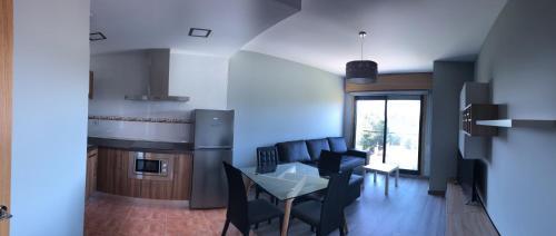 Una cocina o zona de cocina en Apartamentos Augusto