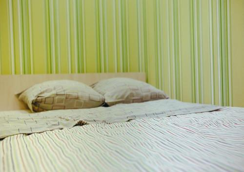 A bed or beds in a room at Sweet Hostel