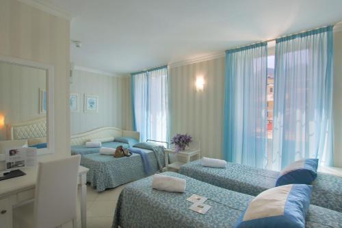 Letto o letti in una camera di Hotel Nazionale