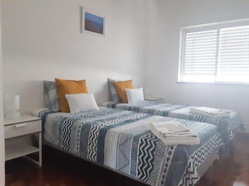 A bed or beds in a room at Appartement plein centre du vieux Faro