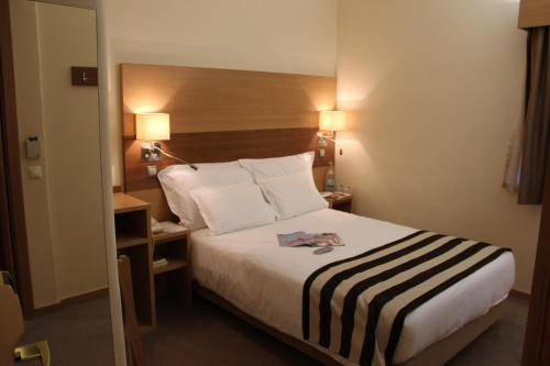 Uma cama ou camas num quarto em Hotel Principe Lisboa