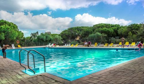 The swimming pool at or near Camping Golfo dell'Asinara