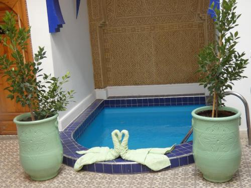 The swimming pool at or close to Riad Bab Lakhmiss