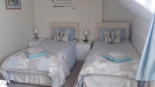 A bed or beds in a room at The Trevelyan