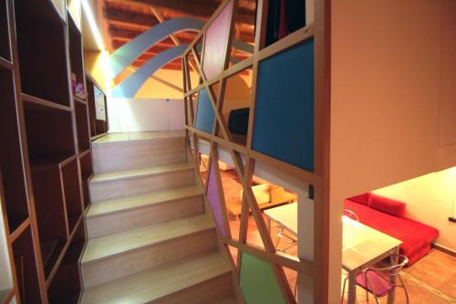 A bunk bed or bunk beds in a room at Loft Panoramico al Centro Storico