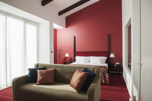 A bed or beds in a room at Real Abadia, Congress & Spa Hotel
