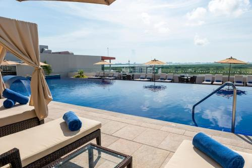 The swimming pool at or near Four Points by Sheraton Cancun Centro