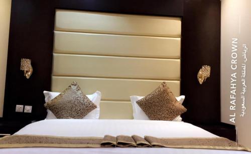Cama ou camas em um quarto em Al Rafahya Crown