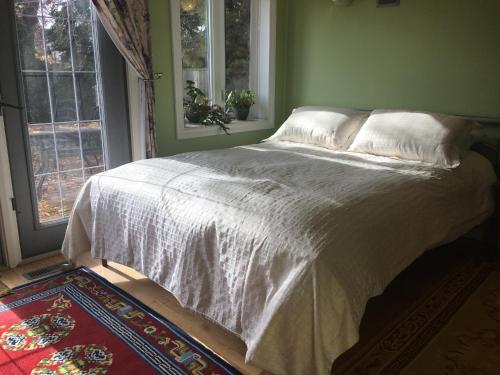 A bed or beds in a room at Mediterranean Edmonton B&B