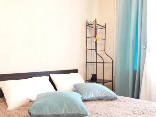 Кровать или кровати в номере Апартаменты Гармония