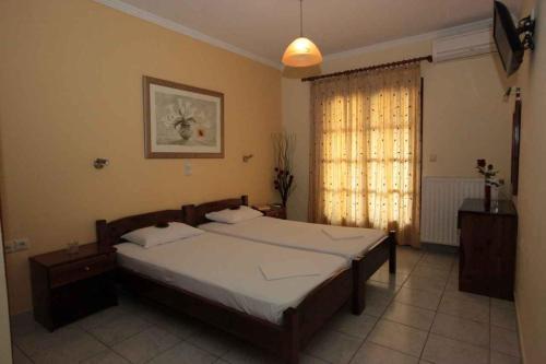 Ένα ή περισσότερα κρεβάτια σε δωμάτιο στο Almini Apartments
