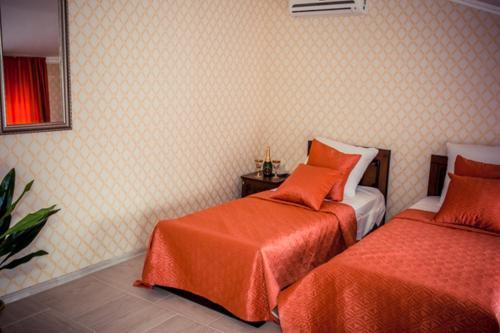 Кровать или кровати в номере Отель «Империя»