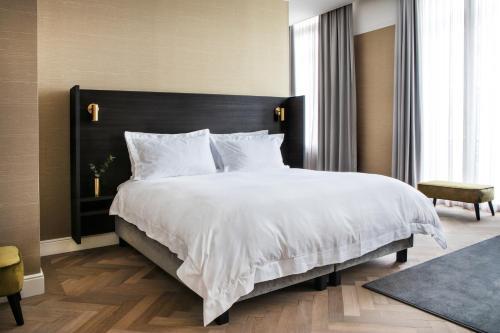 Een bed of bedden in een kamer bij Pillows Grand Boutique Hotel Reylof Ghent