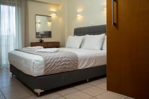 Кровать или кровати в номере Gramvoussa Bay
