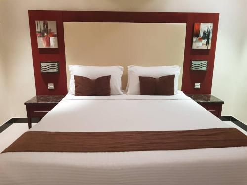 Cama ou camas em um quarto em Al Muhaidb Al Nadwa