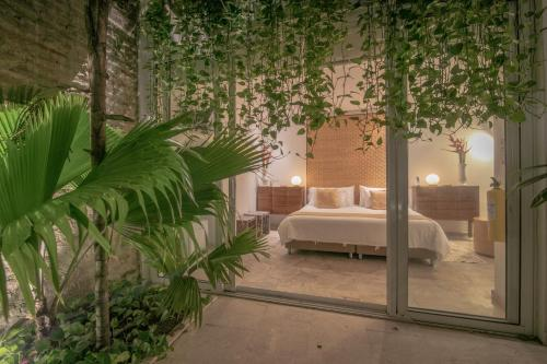 A bed or beds in a room at Casa Claver Loft Boutique Hotel
