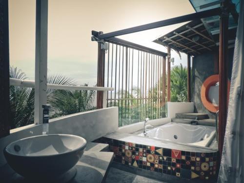 A bathroom at Vartika Resovilla Kuiburi Beach Resort and Villas