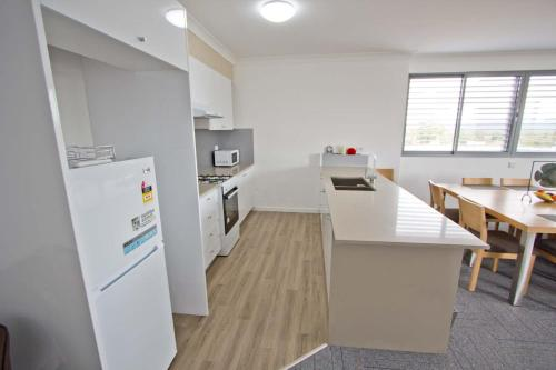 A kitchen or kitchenette at Morisset Serviced Apartments