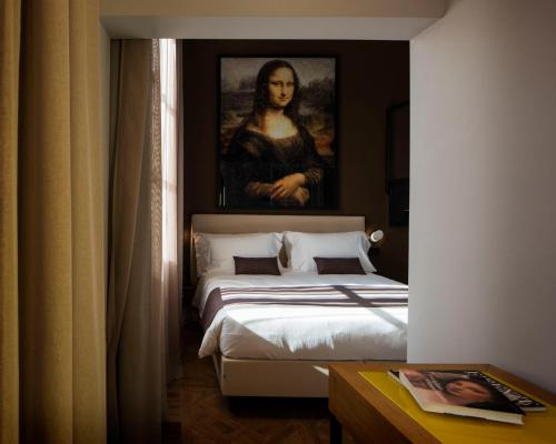 A bed or beds in a room at The Frame Hotel