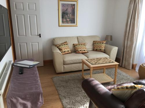 A seating area at Ashbourne Holiday Homes