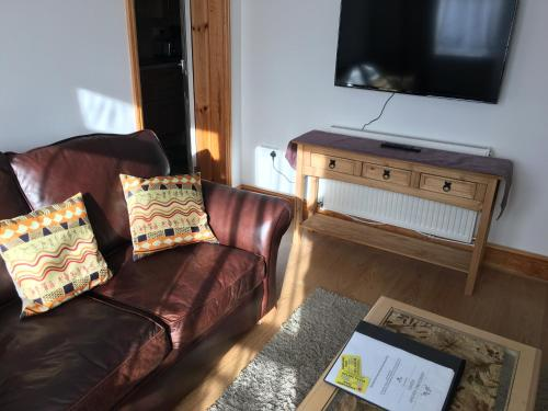 A television and/or entertainment center at Ashbourne Holiday Homes
