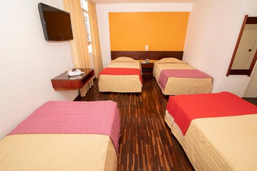 A bed or beds in a room at Hotel Chavín