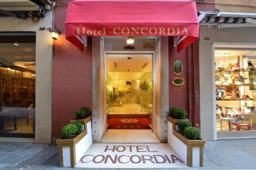 The facade or entrance of Hotel Concordia