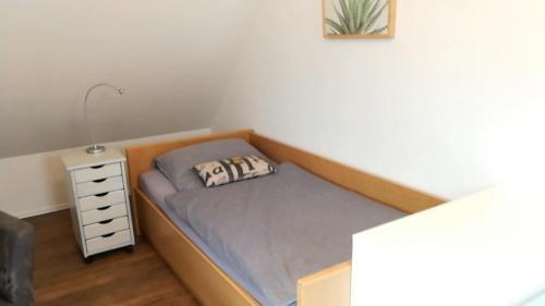 Ein Bett oder Betten in einem Zimmer der Unterkunft Elbe19 Ferienwohnung