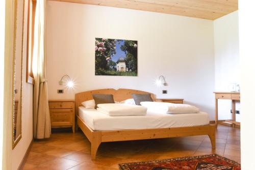 A bed or beds in a room at Agritur Casteller