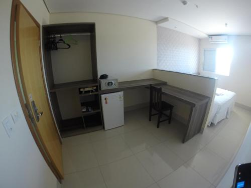 A kitchen or kitchenette at Garcia Palace Hotel