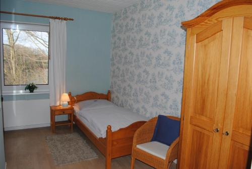 A bed or beds in a room at Hotel Seelust