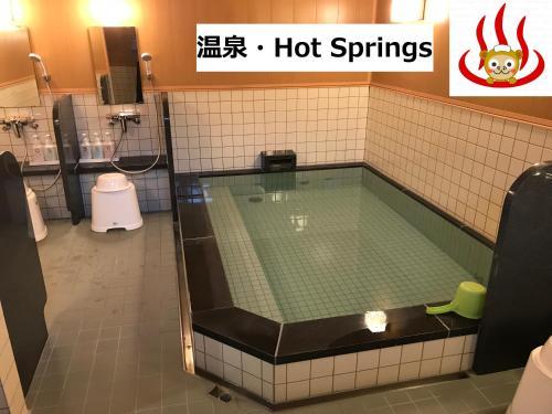 Küche/Küchenzeile in der Unterkunft Hotel Famitic Nikko Station