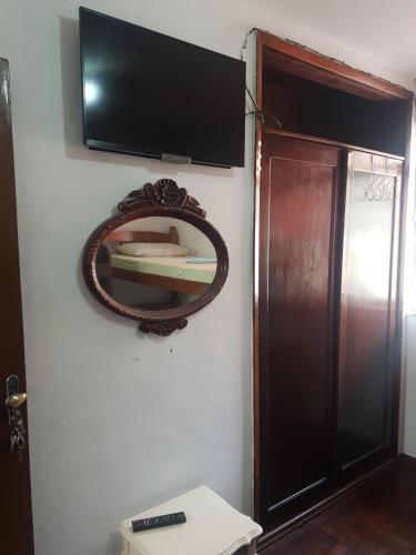 A television and/or entertainment center at Casa na Ilha