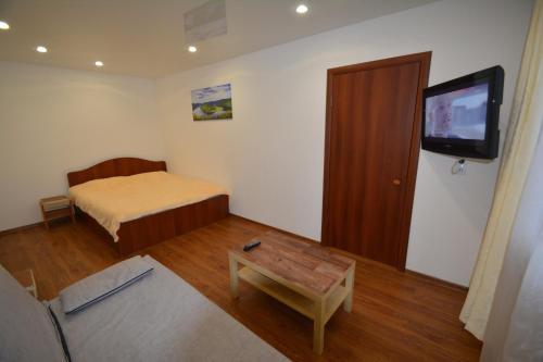 Кровать или кровати в номере Apartment on Moskovskaya