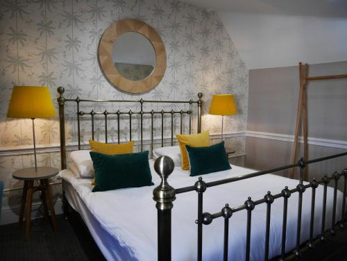 A bed or beds in a room at The Fleece